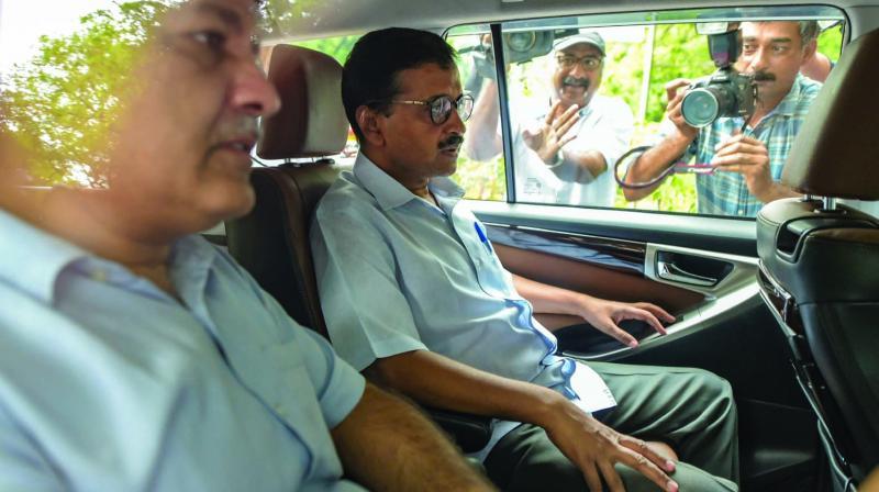 CM Arvind Kejriwal and his deputy Manish Sisodia arrive to meet Union minister Rajnath Singh. (Photo: PTI)