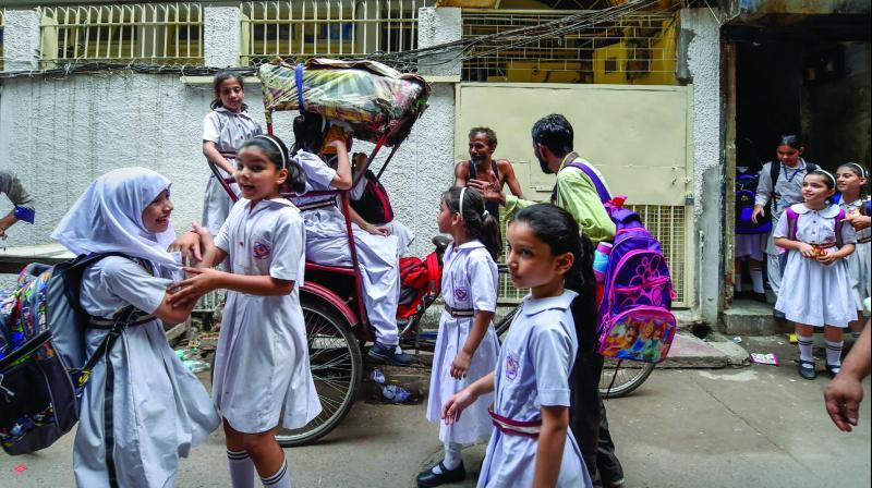 Girl students outside Rabea Girls' Public School's in New Delhi on Wednesday. (Photo: PTI)