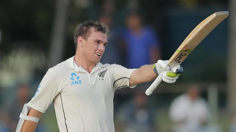 A sparkling century by Tom Latham powered New Zealand's first innings reply after Sri Lanka posted 244 on day three of the rain-hit second Test in Colombo on Saturday.  Latham, on 111, put together an unbeaten 70-run stand with BJ Watling, on 25, to thwart the Sri Lankan bowling attack that had made early inroads into the Kiwi batting. (Photo:AP/PTI)