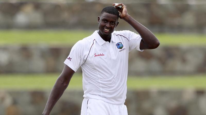 After getting bowled out for 222 in the first innings against India on day three of the first Test match, West Indies skipper Jason Holder expressed disappointment with the top-order, saying the batsmen failed to step up. (Photo:AP)