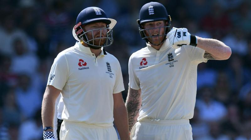 Ben Stokes and Jonny Bairstow maintained England's bid for an extraordinary comeback win in the third Test against Australia at Headingley on Sunday. (Photo:AFP)