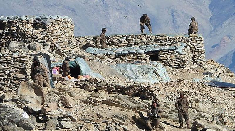 In this undated handout photograph released by the Indian Army on February 16, 2021 shows People Liberation Army (PLA) soldiers during military disengagement along the Line of Actual Control (LAC) at the India-China border in Ladakh. (Indian Ministry of Defence / AFP)