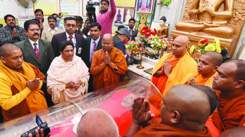BSP president Mayawati pays tribute to Buddhist monk Pragyanand who passed away recently in Lucknow. (Photo: PTI)