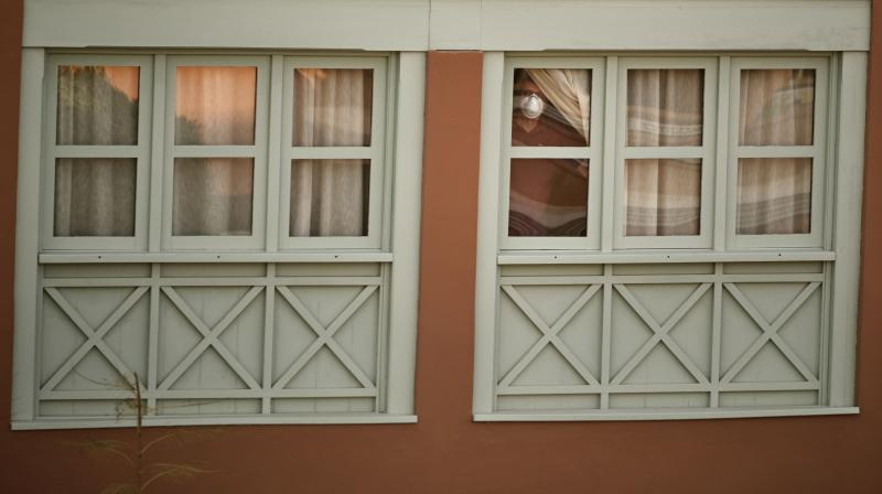 A man looks out of a window at the H10 Costa Adeje Palace hotel in La Caleta, on the Canary Island of Tenerife, Spain, Wednesday, February 26, 2020. Spanish officials say the tourist hotel has been placed in quarantine after an Italian doctor staying there tested positive for the COVID-19 virus and Spanish news media says some 1,000 tourists staying at the complex are not allowed to leave. (AP)