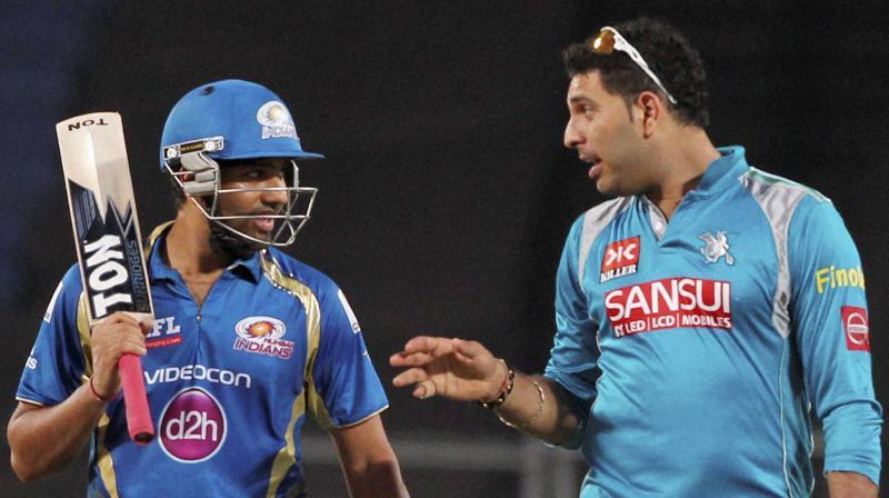 Mumbai Indians Rohit Sharma and Yuvraj Singh of Pune Warriors during their IPL-6 match in Pune. PTI Photo