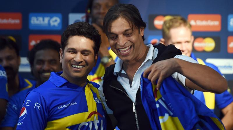 Shoaib Akhtar shares a lighter moment with Sachin Tendulkar. AFP Photo