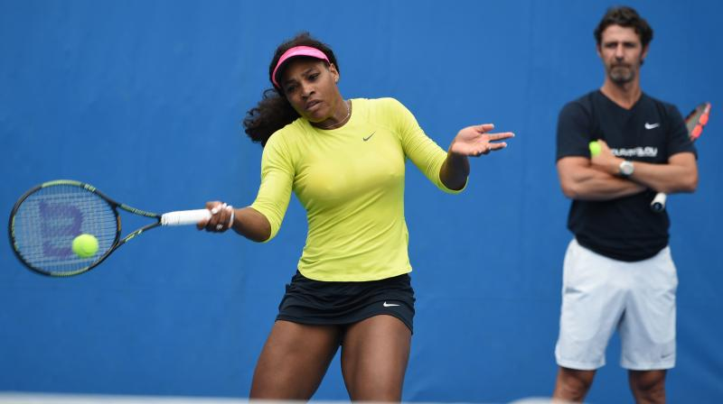 Coach Patrick Mouratoglou watches Serena Williams during a practice session. AFP Photo