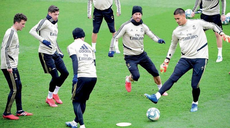 Real Madrid players at a practice session. AFP Photo