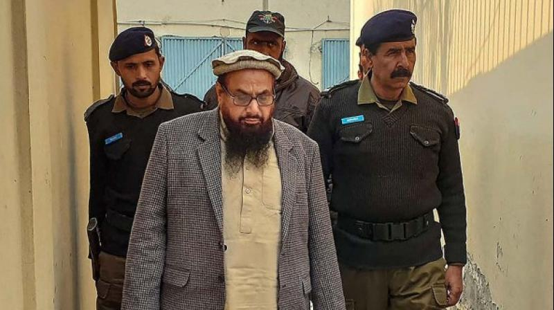 JuD chief Hafiz Saeed being produced at a court in Lahore. (PTI)