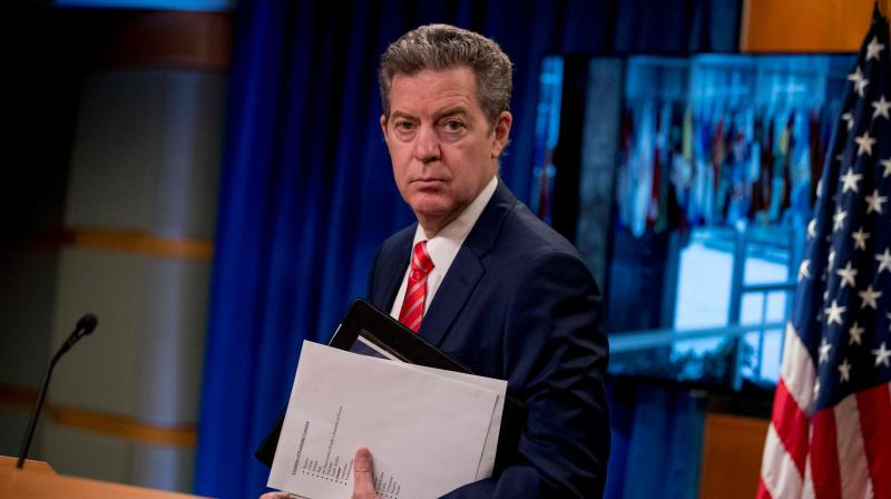Sam Brownback, Ambassador at Large for International Religious Freedom, departing after speaking during a news conference at the State Department in Washington, DC.(AFP)