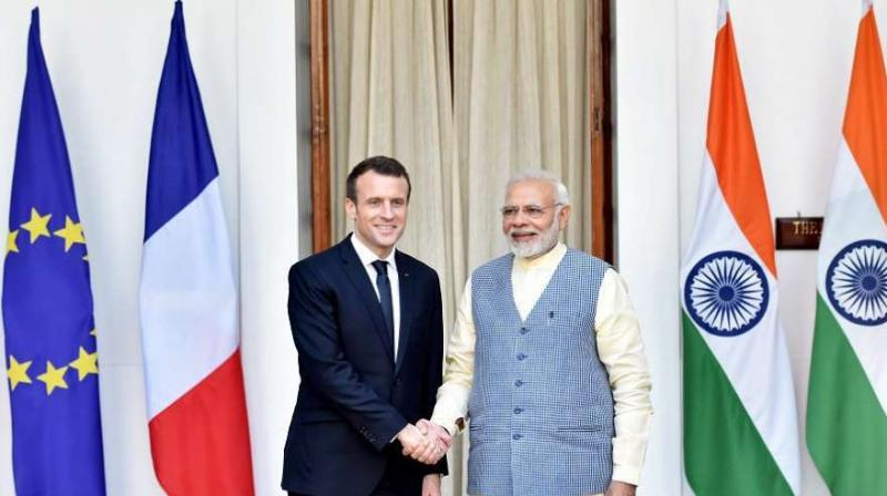 Prime Minister Narendra Modi shakes hand with France's President Emmanuel Macron. (PTI)
