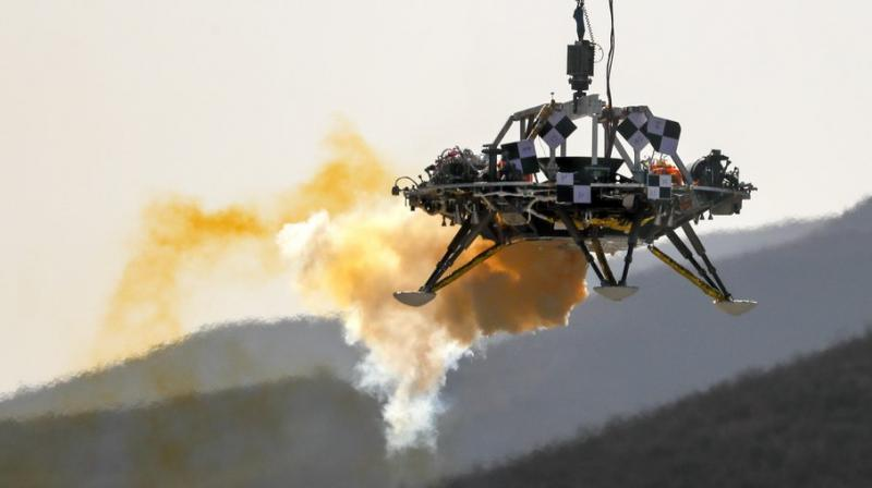 The Mars lander's hovering, obstacle avoidance and deceleration capabilities are tested at a facility at Huailai in China's Hebei province. China will launch their Mars rover and an orbiter sometime around July 23, 2020, in a mission named Tianwen, or Questions for Heaven. (AP)