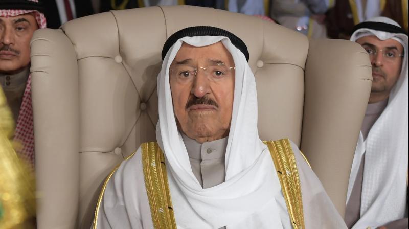 Kuwait's ruling emir, Sheikh Sabah Al Ahmad Al Sabah (center). (AP)