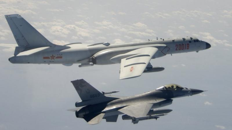 A Taiwanese Air Force F-16 in foreground flies on the flank of a Chinese People's Liberation Army Air Force (PLAAF) H-6 bomber as it passes near Taiwan. (Republic of China (ROC) Ministry of National Defense via AP)