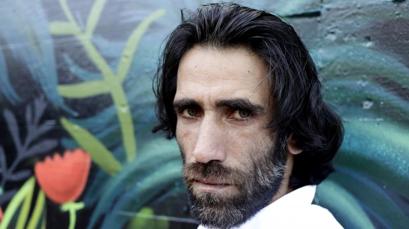 Behrouz Boochani, the Kurdish film-maker, writer and refugee who has documented life inside the Australian offshore immigration camp on Manus Island, poses for a portrait in Christchurch, New Zealand. (AP)