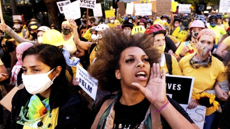 Black Lives Matter organizer Teal Lindseth, 21, leads protesters. (AP)