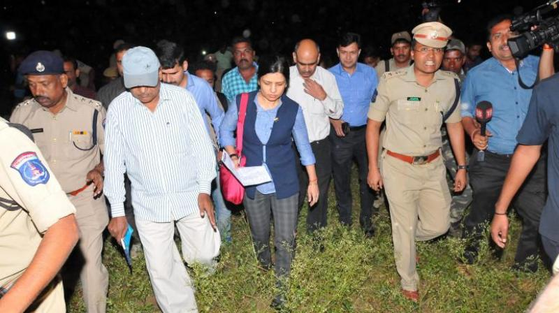 A team of National Human Rights Commission from Delhi inspect the spot where the four accused of rape and murder of Disha were gunned down in an exchange of fire on the outskirts of Chattanpally on Saturday. (Photo: P. Surendra)
