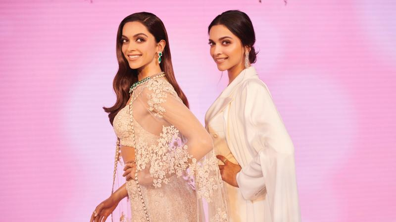 Deepika Padukone poses with her Statue of Purpose.
