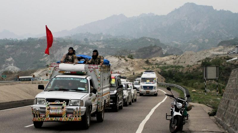 A security vehicle escorts the first batch of Amarnath pilgrims, on way to the holy shrine, at Jammu-Srinagar national highway near Jammu. (Photo: PTI)