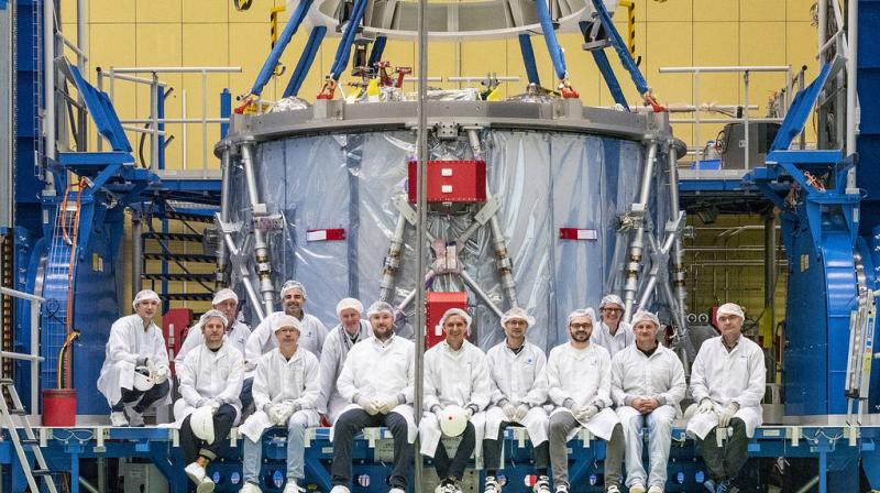 The Airbus team poses with the European Service Module during preparations for shipment to NASA's Kennedy Space Center. (Image Credit: NASA/Rad Sinyak)