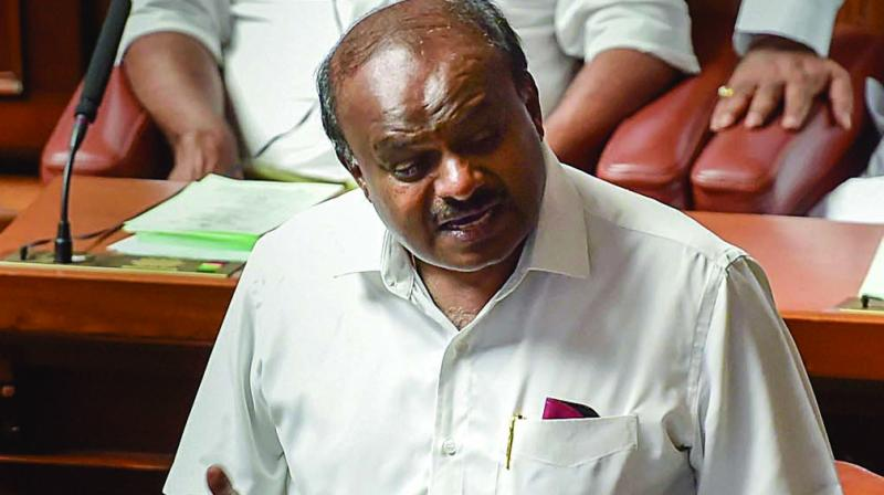 Karnataka chief minister H.D. Kumaraswamy speaks at the Assembly session at Vidhana Soudha in Bengaluru on Thursday.