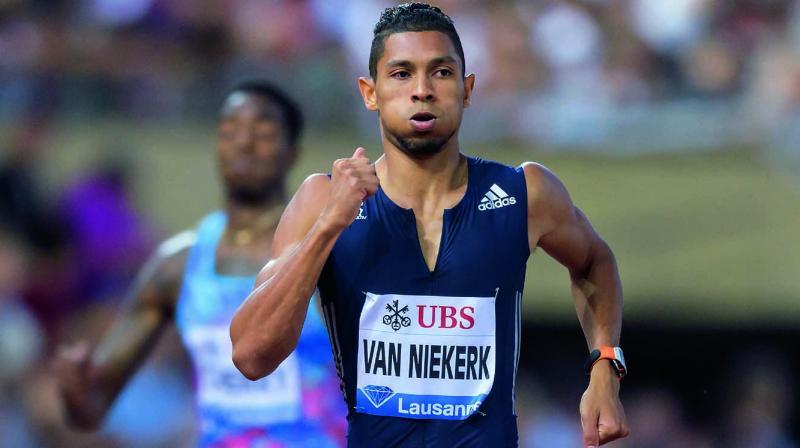 South Africa's Wayde Van Niekerk en route to winning the mens' 400m gold in the Diamond League athletics meet in Lausanne. (Photo: AFP)
