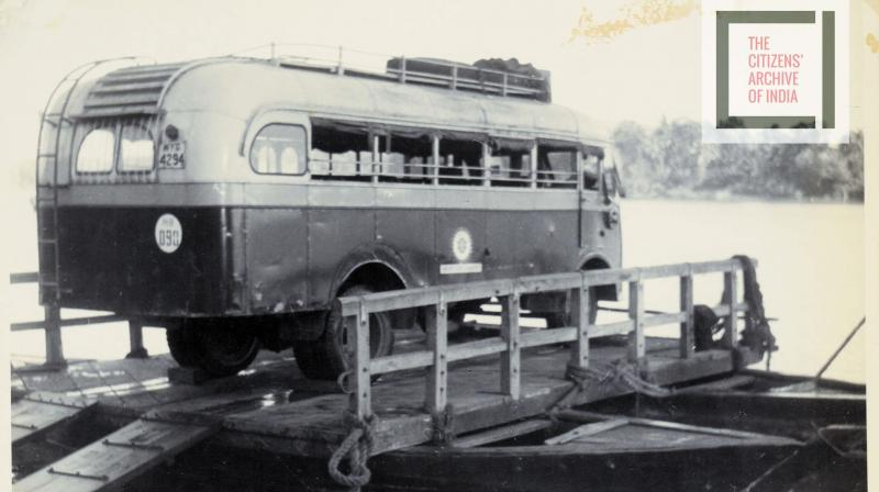 Before bridges were built for the Konkan Railway, vehicles were taken across the river by plopping them over a plank on boats.