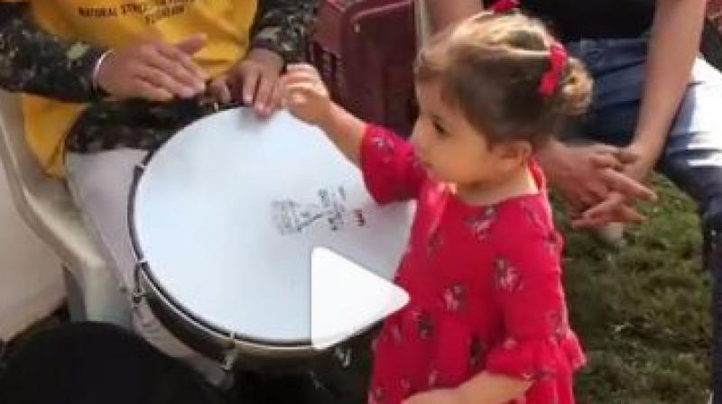 Screen capture from Misha playing the drum.