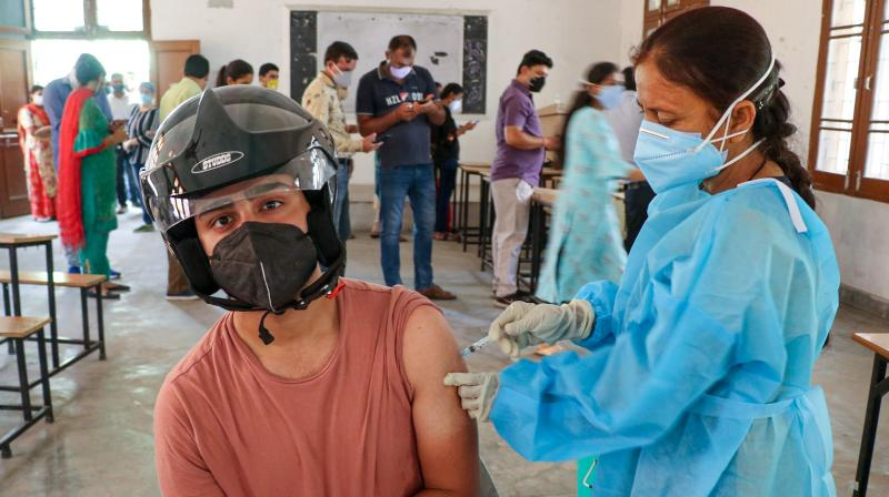 A beneficiary receives a dose of Covid-19 vaccine at a vaccination centre in Jammu. (Photo: PTI)