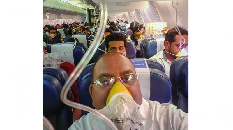 Passengers on board the Mumbai-Jaipur Jet Airways flight wear oxygen masks after cabin pressure dropped. (Photo:PTI)