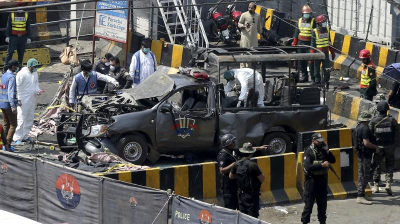 Three elite police force officials were killed in the blast. A civilian and a security guard also lost their lives in the attack. (Photo: AP)