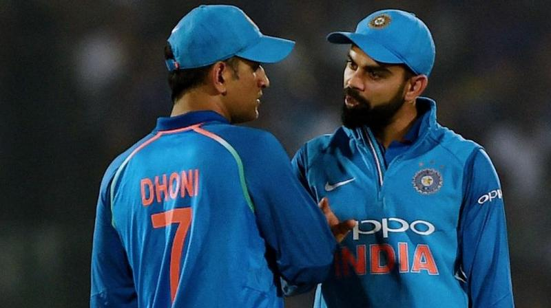 India captain Virat Kohli on Tuesday said he hasn't had any conversation with Sourav Ganguly with regards to Mahendra Singh Dhoni's international future and believes that the BCCI's President-elect will get in touch with him when he needs to. (Photo:AFP)