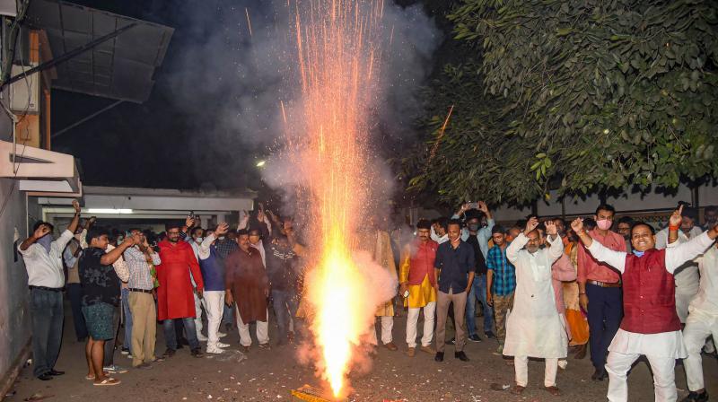 BJP workers celebrate in Patna.