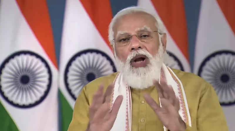 Prime Minister Narendra Modi virtually addresses the launch of Ayushman Bharat Digital Mission, in New Delhi, Monday, Sept. 27, 2021. (PTI Photo)