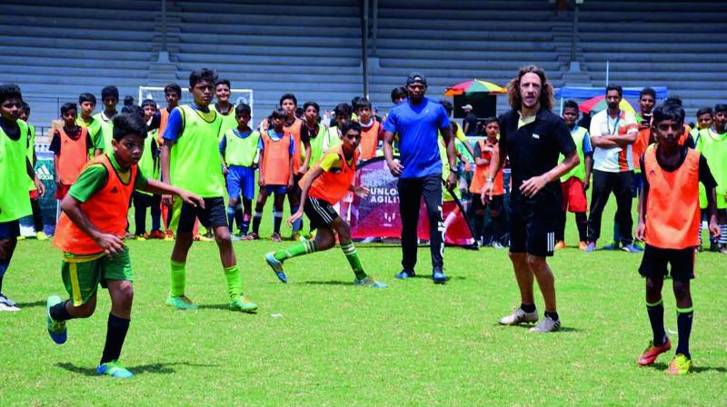 Carles Puyol (second from right) with school children at the Mission XI Million festival on Wednesday. (Photo: PTI)