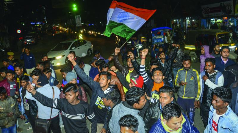 People celebrate in Dibrugarh after the IAF's strike in Balakot on JeM camps. (Photo: PTI)