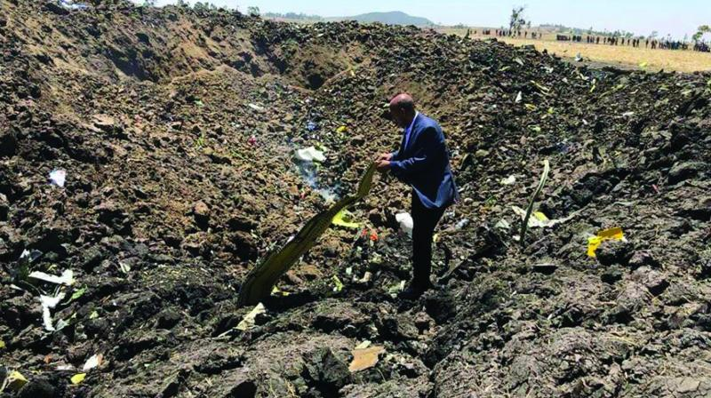 CEO of Ethiopian Airlines Tewolde Gebremariam looks at the wreckage of the plane that crashed shortly after takeoff from Addis Ababa, Ethiopia. (Photo: AP)