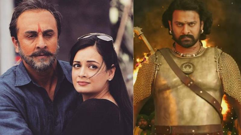 Stills from 'Sanju' and 'Baahubali: The Conclusion.'