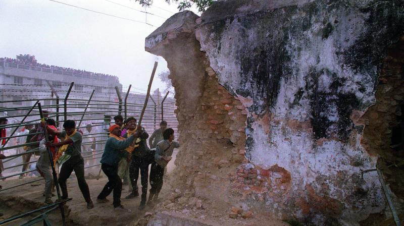In this file photo, people demolish a structure that was part of the Babri Masjid.