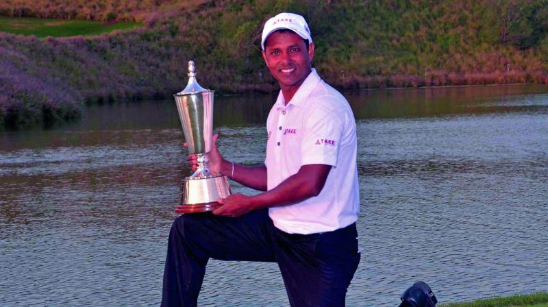 S S P Chawrasia poses with the winner's trophy.