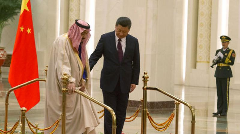 Chinese President Xi Jinping and Saudi Arabia's King Salman inspect a Chinese guard of honor during a welcome ceremony in Beijing, China. (Photo: AP)