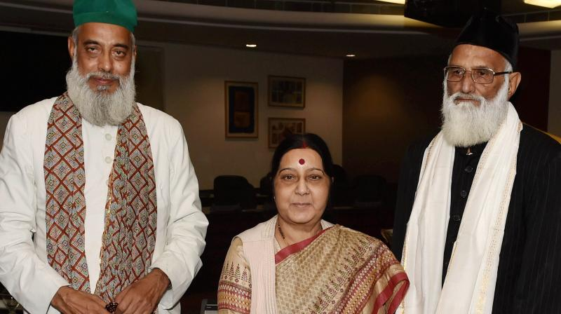 External Affairs Minister Sushma Swaraj with Syed Asif Nizami, the head priest of Hazrat Nizamuddin Aulia Dargah, and his nephew Nazim Ali Nizami, who went missing in Pakistan last week, after a meeting at Jawaharlal Bhawan in New Delhi.
