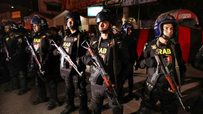Bangladeshi soldiers from Rapid Action Battalion or RAB stand guard where a suicide bomber allegedly detonated himself in Dhaka. (Photo: AP)