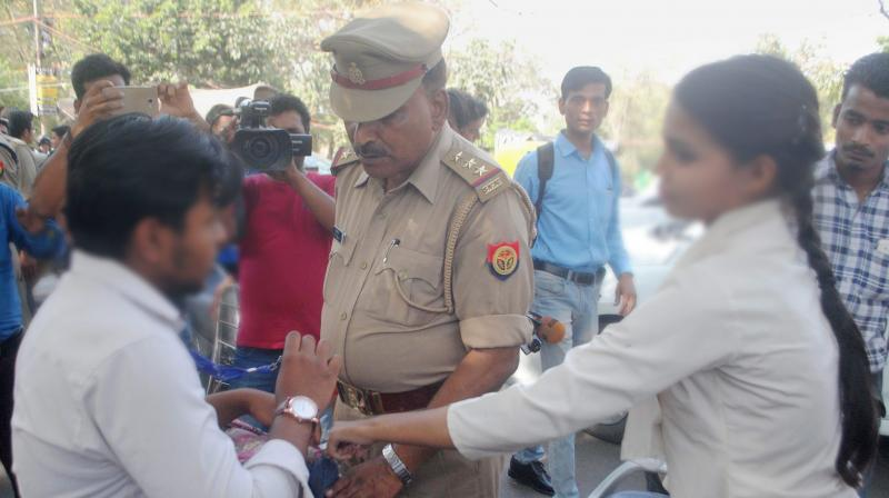 Anti-Romeo squad of police hauls up a youth in Lucknow. (Photo: PTI)