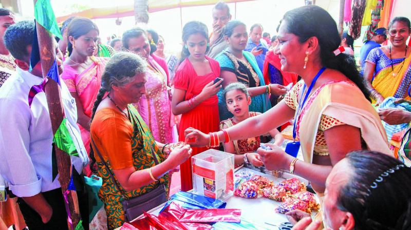A file photo from last year's fair where a participant is selling articles at a stall.