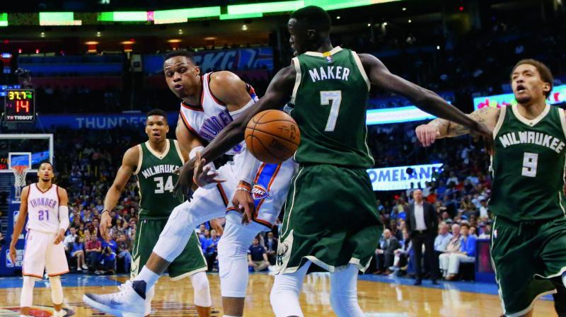 Oklahoma City Thunder's Russell Westbrook beats Milwaukee Bucks' Thon Maker in Oklahoma City. (Photo: AP)