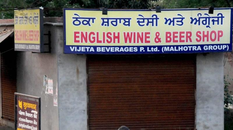 A closed liquor shop as the Supreme Court order to ban liquor vends located within 500 meters of Punjab's National and State Highways from April 1 in Amritsar. (Photo: PTI)