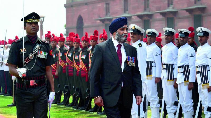Canadian defence minister Harjit Singh Sajjan receives the guard of honour at South Block in New Delhi. (Photo: PTI)