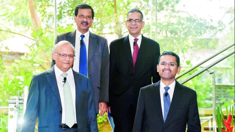TCS executive V-P and global resources head Ajoyendra Mukherjee, TCS CEO & MD Rajesh Gopinathan, TCS COO N. Ganapathy Subramaniam and TCS CEO V. Ramakrishnan ahead of declaring Q4 results. (Photo: PTI)