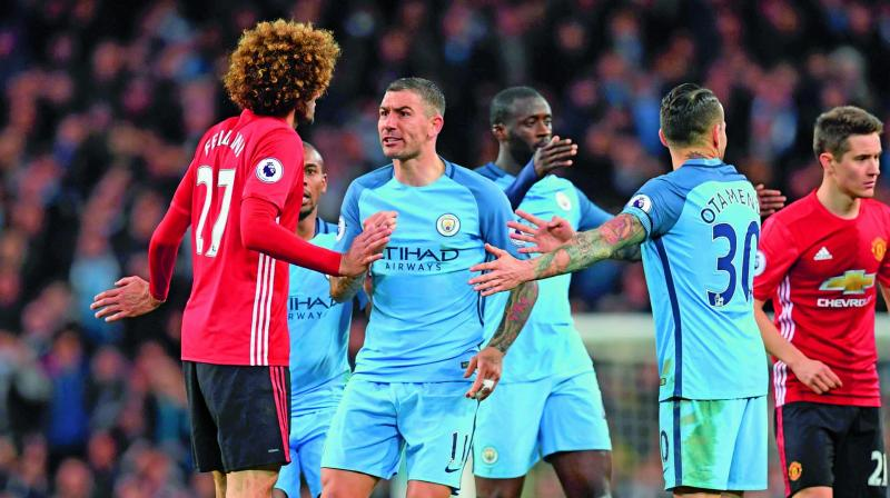 Both sides of the Manchester divide will be hoping some derby delight can add impetus to disappointing seasons when City host United on Saturday. ( Photo: AFP)